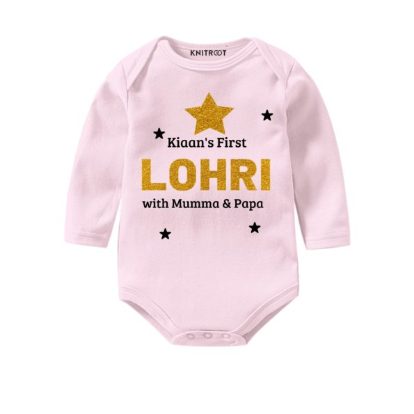 First lohri with parents in pink onesie
